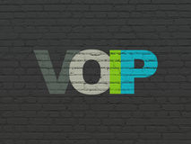 Web design concept: VOIP on wall background. Web design concept: Painted multicolor text VOIP on Black Brick wall background Royalty Free Stock Photos