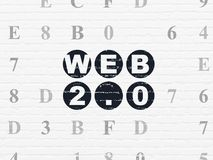 Web design concept: Web 2.0 on wall background. Web design concept: Painted black text Web 2.0 on White Brick wall background with Hexadecimal Code Stock Photography