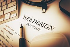 Web Design Contract. Documents to Sign and Desk Equipment Around. Web Design Business Concept Royalty Free Stock Photos