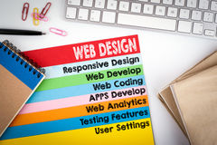 Web Design and Development. Office desk with a computer keyboard and color pages.  Royalty Free Stock Images