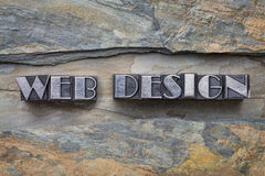Web design in metal type. Web design words in letterpress metal type against slate rock background Stock Photos