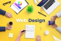 Web design team work on project concept. Yellow desk with web design text royalty free stock images