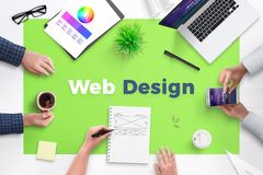 Web design text on office desk. Concept of web development team work space royalty free stock image