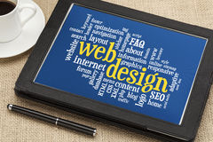 Web design word cloud. On a  digital tablet with a cup of coffee Stock Photography