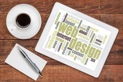 Web design word cloud on tablet. Web design word cloud on a digital  tablet with a cup of coffee on a rustic wooden table Stock Photo