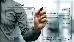 Web designer drawing website wireframe