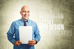 Web designer holding paper Royalty Free Stock Photos