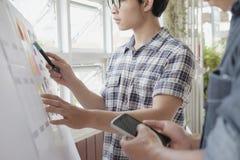 Web designer planning application for mobile phone. Web designer, UX UI designer planning application for mobile phone Royalty Free Stock Photography