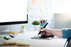Web designer, UX UI designer working to design screen. Web designer, UX UI designer planning application for mobile phone. Responsive web desingn and mobile Stock Photo