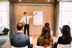 Web designers standing at office planning website layout on flipchart Royalty Free Stock Photo