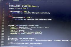 Web developer PHP code close up. Charging customer using Stripe API. Online payments processing. Abstract information technonology modern background. Concept Royalty Free Stock Image