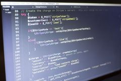 Web developer PHP code close up. Charging customer using Stripe API. Online payments processing. Abstract information technonology modern background. Concept Stock Photos
