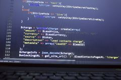 Web developer PHP code close up. Charging customer using Stripe API. Online payments processing. Abstract information technonology modern background. Concept Royalty Free Stock Photo