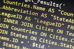 Web developer PHP code close up. Macro shot of complicated SQL query to database. Abstract information technology modern background. Concept screen of stock photo