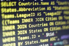 Web developer PHP code close up. Macro shot of complicated SQL query to database. Abstract information technology modern background. Concept screen of Stock Photography