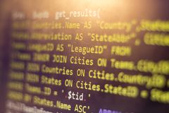 Web developer PHP code close up. Macro shot of complicated SQL query to database. Abstract information technology modern background. Concept screen of Stock Images