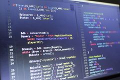 Web developer PHP and CSS3/LESS/SASS code close up. Database connecting code. Abstract information technology modern background. Concept screen of experienced Royalty Free Stock Photo
