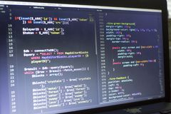 Web developer PHP and CSS3/LESS/SASS code close up. Database connecting code. Abstract information technology modern background. Concept screen of experienced Royalty Free Stock Image