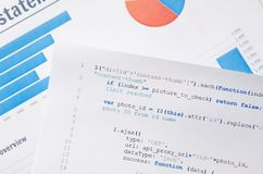Web developer programming code printed on a piece of paper Royalty Free Stock Photos