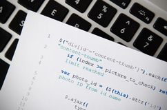 Web developer programming code printed on a piece of paper Stock Photos