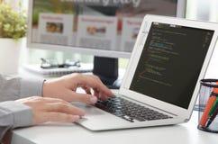 Web developer is working on new website. Web developer designer web code programmer computer application programming concept stock images