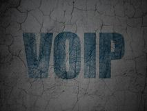 Web development concept: VOIP on grunge wall background. Web development concept: Blue VOIP on grunge textured concrete wall background Royalty Free Stock Photography