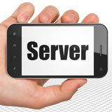 Web development concept: Hand Holding Smartphone with Server on display Stock Images