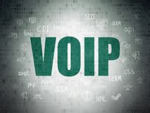 Web development concept: VOIP on Digital Data Paper background. Web development concept: Painted green text VOIP on Digital Data Paper background with  Hand Stock Photography