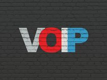 Web development concept: VOIP on wall background. Web development concept: Painted multicolor text VOIP on Black Brick wall background Stock Photos
