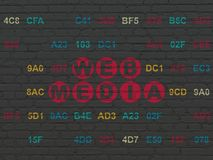 Web development concept: Web Media on wall background. Web development concept: Painted red text Web Media on Black Brick wall background with Hexadecimal Code Royalty Free Stock Images