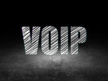 Web development concept: VOIP in grunge dark room. Web development concept: Glowing text VOIP in grunge dark room with Dirty Floor, black background, 3d render royalty free stock photo