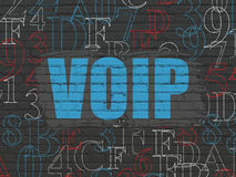 Web development concept: VOIP on wall background. Web development concept: Painted blue text VOIP on Black Brick wall background with Hexadecimal Code, 3d render stock photography