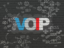 Web development concept: VOIP on wall background. Web development concept: Painted multicolor text VOIP on Black Brick wall background with Scheme Of Hand Drawn stock photos