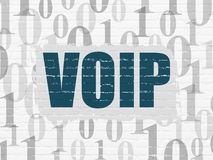 Web development concept: VOIP on wall background. Web development concept: Painted blue text VOIP on White Brick wall background with  Binary Code Stock Image