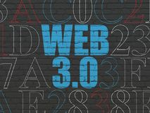 Web development concept: Web 3.0 on wall background. Web development concept: Painted blue text Web 3.0 on Black Brick wall background with Hexadecimal Code Royalty Free Stock Photography