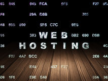 Web development concept: Web Hosting in grunge. Web development concept: Glowing text Web Hosting in grunge dark room with Wooden Floor, black background with royalty free stock photo