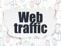 Web development concept: Web Traffic on Torn Paper background. Web development concept: Painted black text Web Traffic on Torn Paper background with  Binary Code Royalty Free Stock Photography