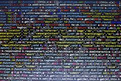 Web development javascript HTML5 code. Abstract information technology modern background. Network hacking. Lines of minificated JS code. Screen of web stock photo