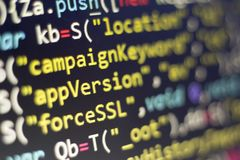 Web development javascript HTML5 code. Abstract information technology modern background. Network hacking. Lines of minificated JS code. Screen of web royalty free stock photo