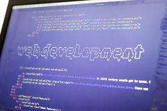 Web development phrase ASCII art inside real HTML code. Web developing concept on screen. Abstract information technology modern background. Digital art. Code Royalty Free Stock Image
