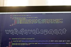Web development phrase ASCII art inside real HTML code. Web developing concept on screen. Abstract information technology modern background. Laptop in sunset Royalty Free Stock Photos