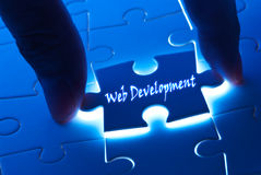 Web development on puzzle piece stock image