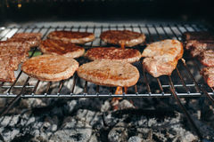Grilling meat and hamburgers. Home grilling meat and hamburgers Royalty Free Stock Photography
