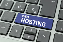Web hosting button. Blue Web hosting button on computer keyboard Royalty Free Stock Photography