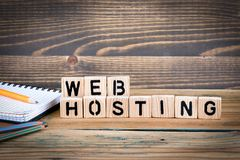 Web hosting. Wooden letters on the office desk, informative and communication background royalty free stock image
