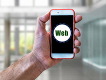 Web Marketing Concept Hand holding mobile phone. Close Royalty Free Stock Photo