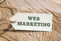 Web Marketing. Word written on a Looking card Stock Images