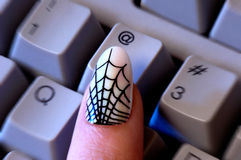 Web Print Woman's Fingernail Reaching for '@' Key Royalty Free Stock Photography