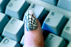 Web Print Woman's Fingernail Reaching for '$' Key Royalty Free Stock Photos