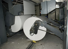 Web (roll) offset press. Detail of double circumference web press, designed for high-quality, high-pagination commercial and publication printing. Offset Stock Image